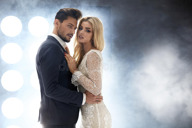 Elegant, attractive couple in the night club royalty free stock photo