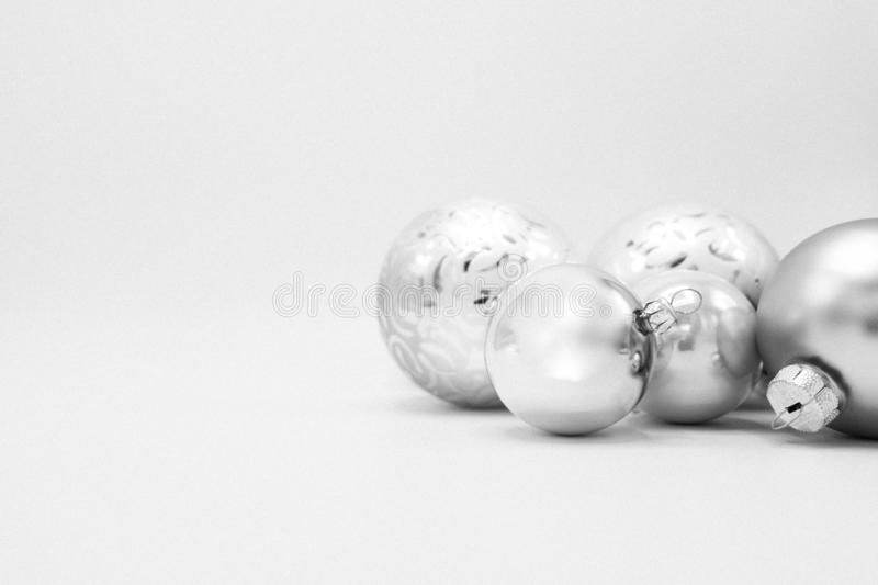 Elegant background of Christmas decorations. Monochrome elegant Christmas wallpaper background of tree decorations. Classy holidays image in black and white stock image