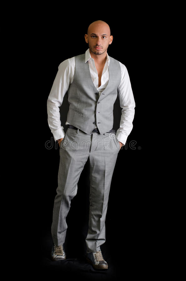Elegant, bald young man in business suit stock image