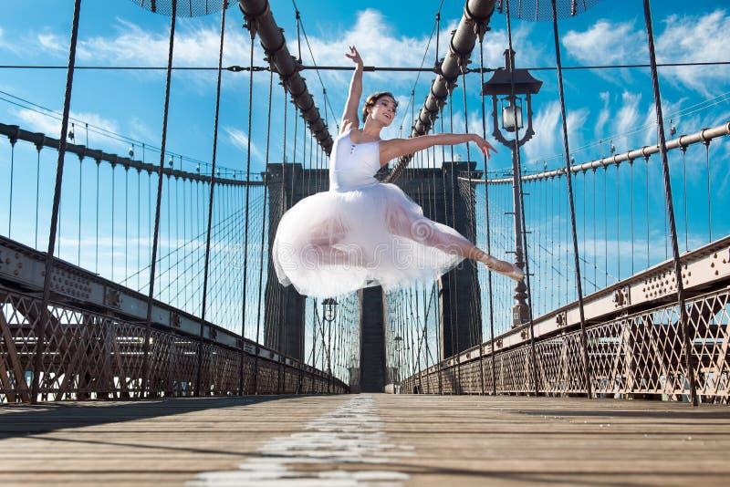Elegant ballet dancer woman dancing ballet in the city royalty free stock images