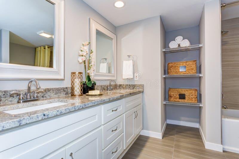 Elegant bathroom with long white vanity cabinet stock images