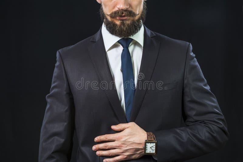 Elegant bearded businessman in dark suit royalty free stock photography