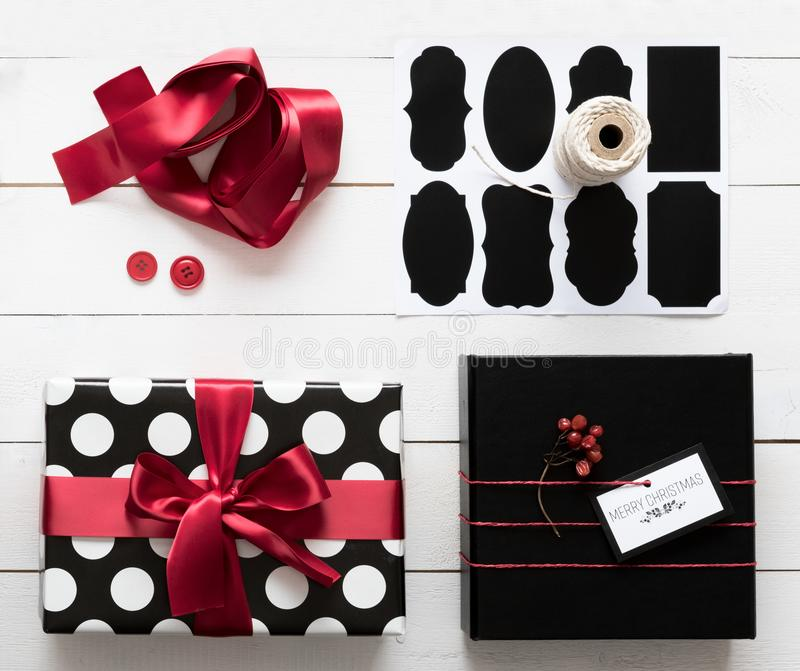 Elegant and beautiful black, red and white christmas presents, diy wrapping. Station royalty free stock photo