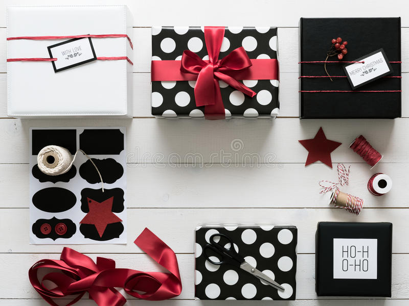 Elegant and beautiful black, red and white christmas presents. Wrapping station stock images