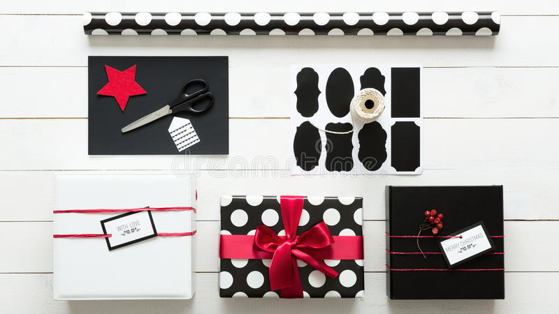 Elegant and beautiful black, red and white christmas presents. Wrapping station stock photos