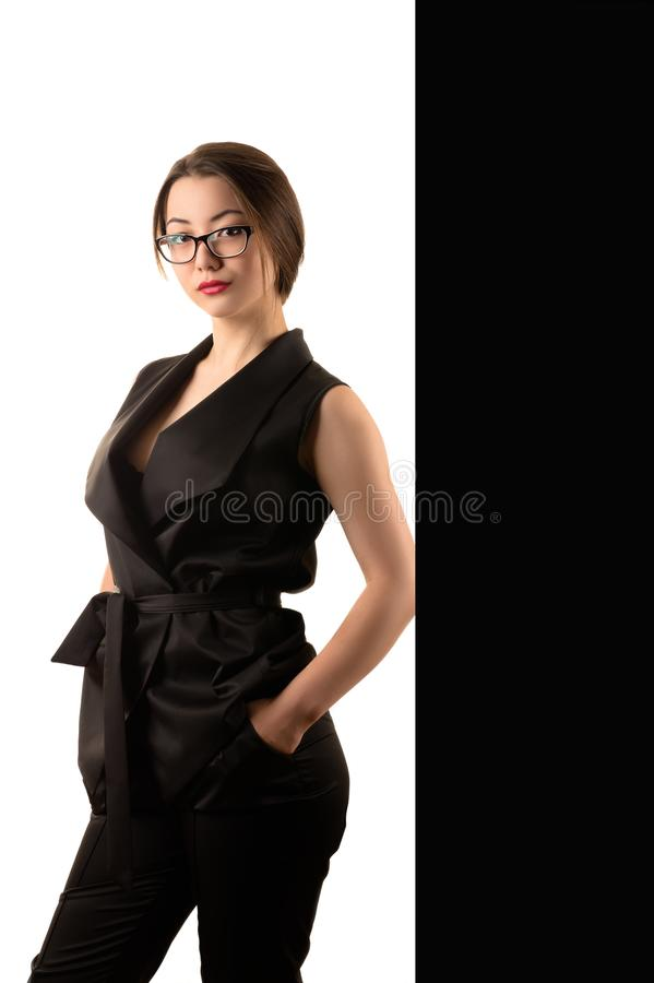 Elegant beautiful business woman in black suit royalty free stock photo