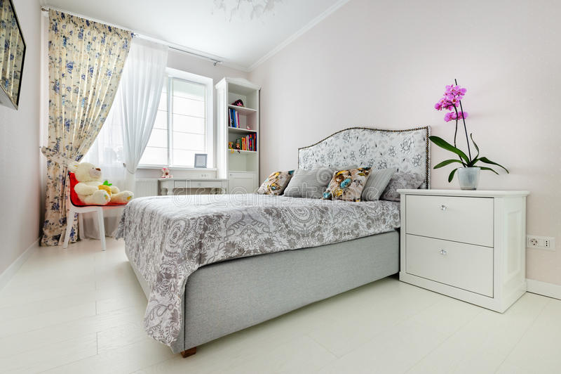 Elegant bedroom in soft light colors royalty free stock image