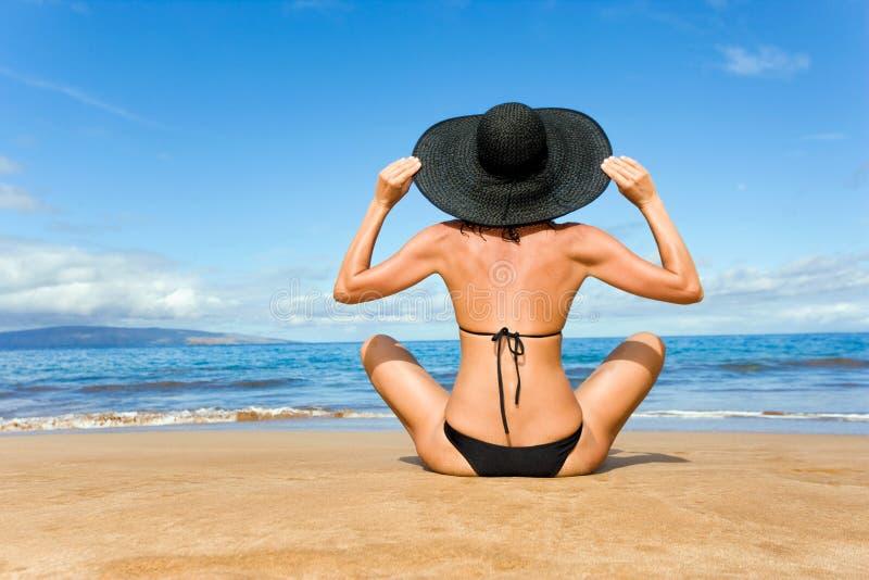 elegant Black bikini woman beach stock photography