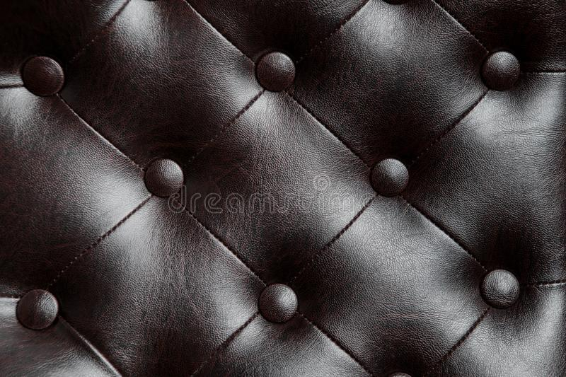 Elegant black leather texture of armchair with buttons for pattern and background. Elegant black leather texture of armchair with buttons for pattern and stock photo