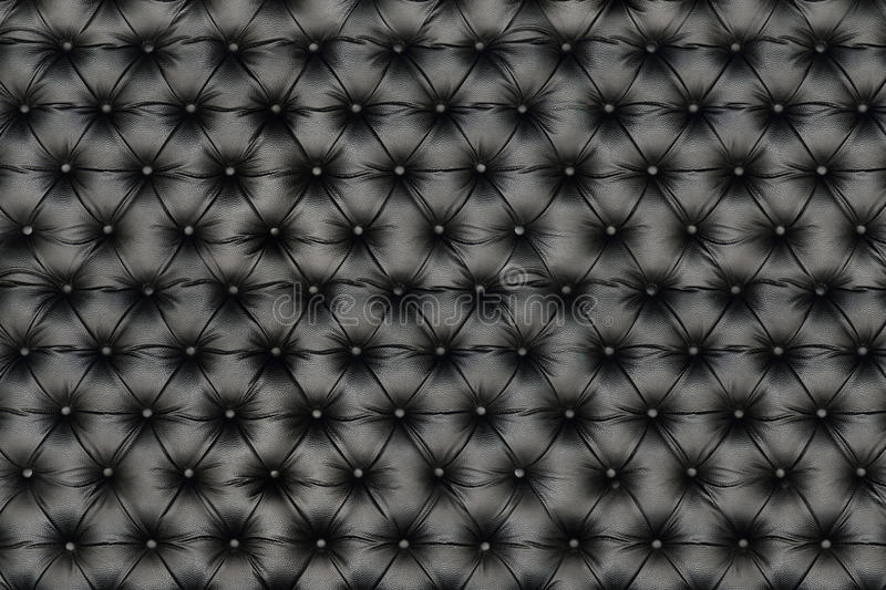 Elegant black leather texture with buttons for pattern and backg. It is elegant black leather texture with buttons for pattern and background royalty free stock images