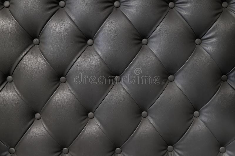 Elegant black leather texture with buttons for pattern and background stock image