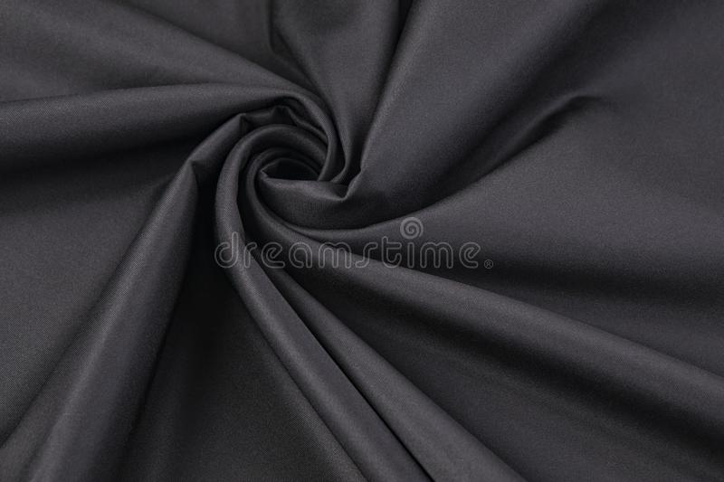 Elegant black satin silk with waves. Background or texture royalty free stock images