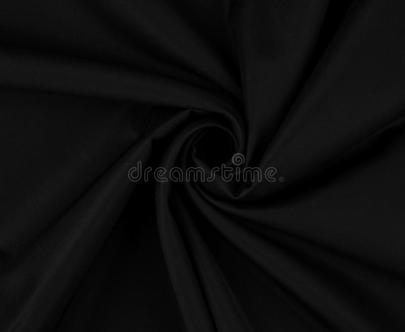 Elegant black satin silk with waves. Background or texture stock images