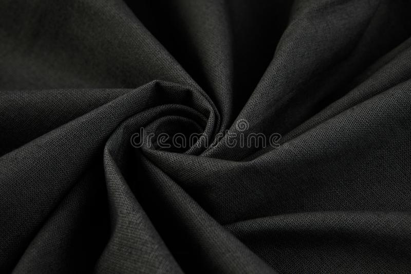 Elegant black satin silk with waves. Background or texture stock photography