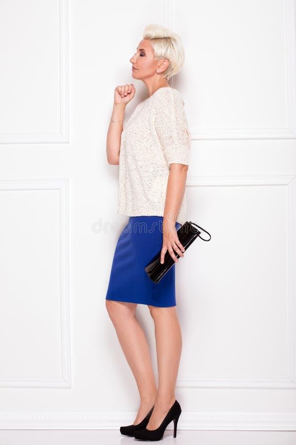 Elegant blonde businesswoman posing. royalty free stock photography