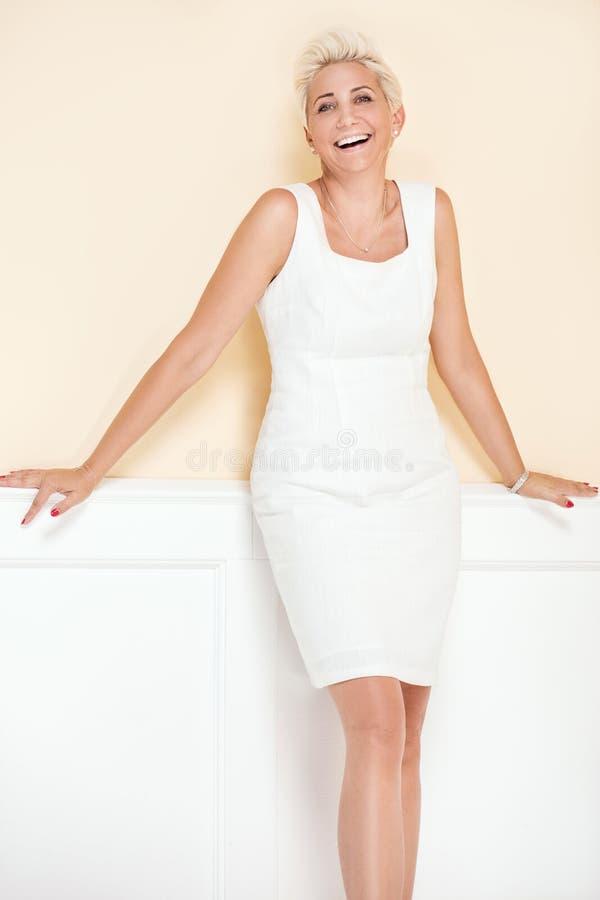 Elegant blonde luxury woman posing. stock photo