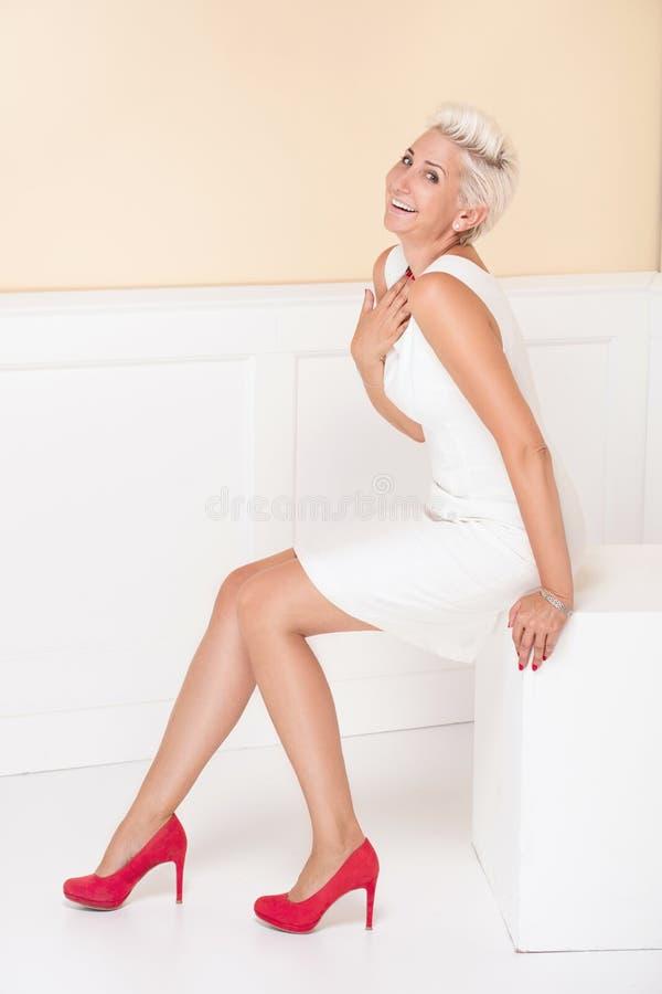 Elegant blonde luxury woman posing. royalty free stock photography