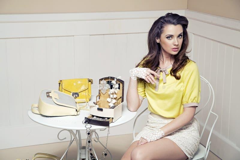 Elegant, bold lady in luxury room stock photography