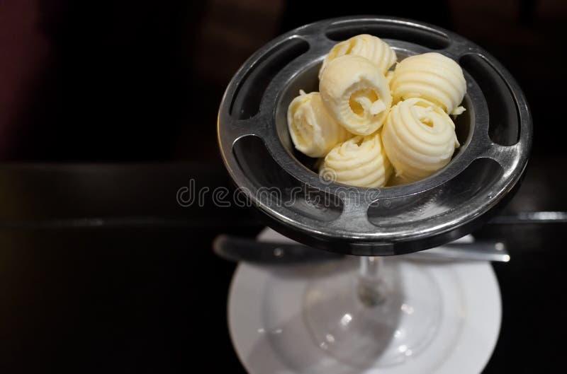Elegant bowl of fresh butter curls serving in restaurant stock images