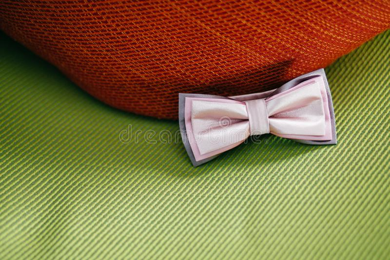 Elegant bowtie against green background. Festive clothes for broom. Formal male accessory. Wedding details. Close up stock images