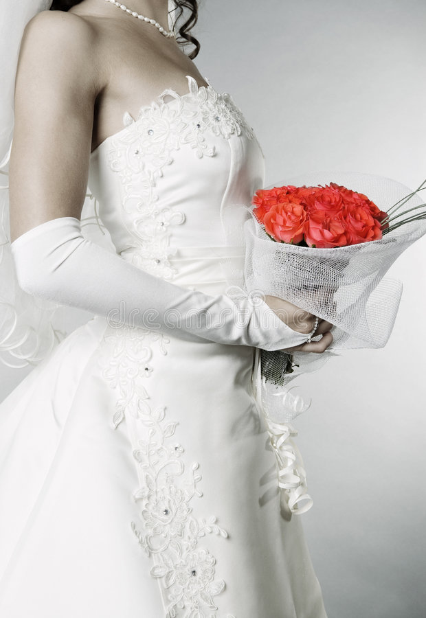 Elegant bride with bunch of roses royalty free stock photography
