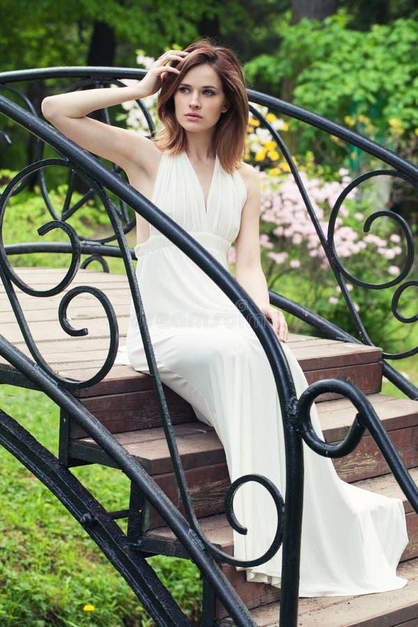 Elegant bride girl in white dress outdoor. Beautiful woman portrait royalty free stock photo