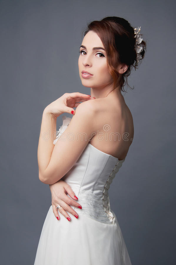Elegant bride with short hair updo and bare shoulders dress stock images