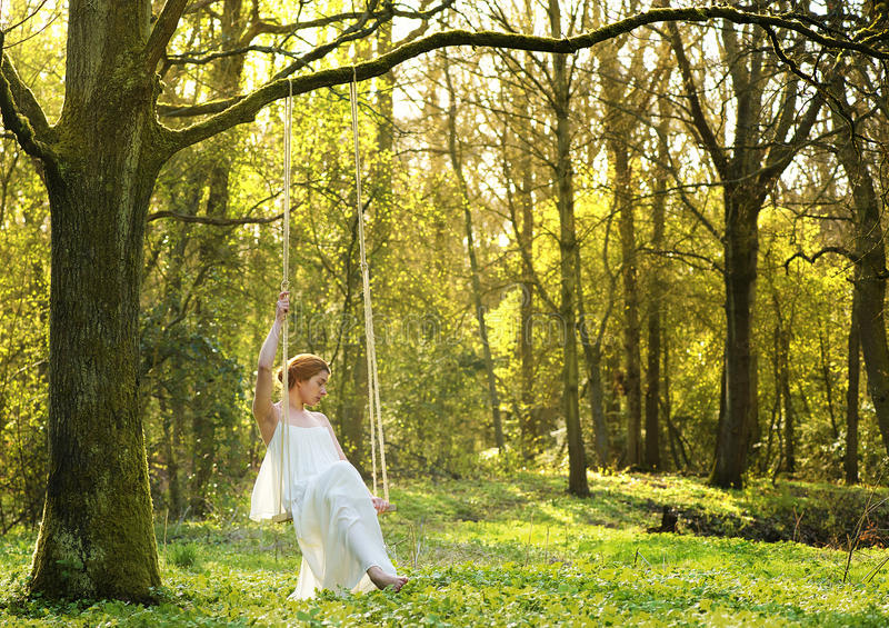 Download Elegant Bride In White Wedding Dress Sitting Alone On Swing Outdoors Royalty Free Stock Photo - Image: 30614485