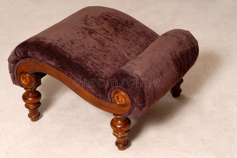 Elegant brown ottoman in a living room royalty free stock image