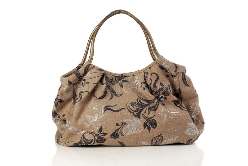 Elegant brown women`s handbag. Isolated on a white background. stock photo