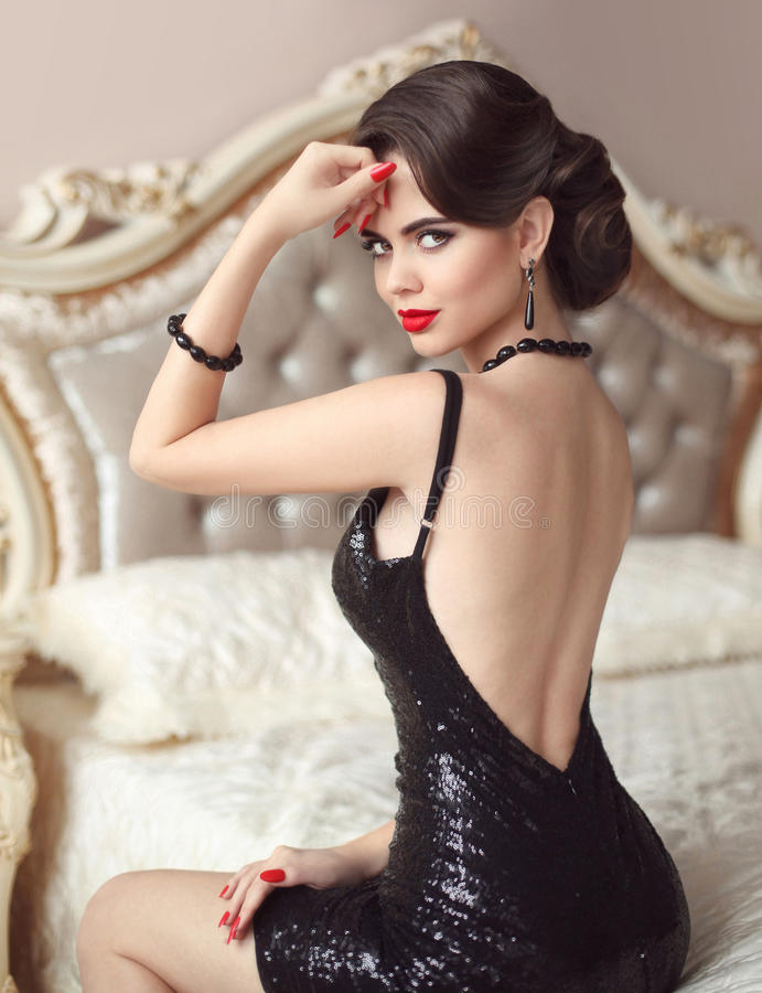 Elegant brunette woman in fashionable black dress. Attracti royalty free stock images