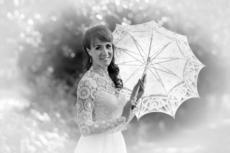 Elegant brunette in a vintage white dress stock photos
