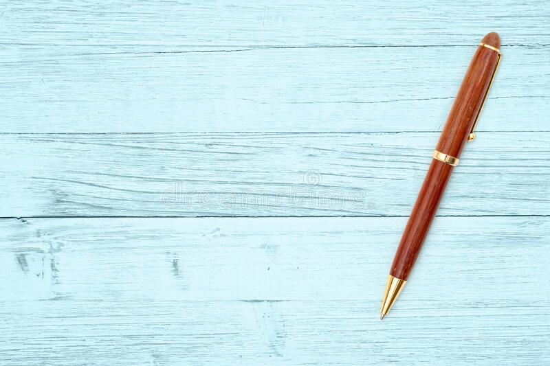 Elegant business brown and gold wood ballpoint pen royalty free stock images