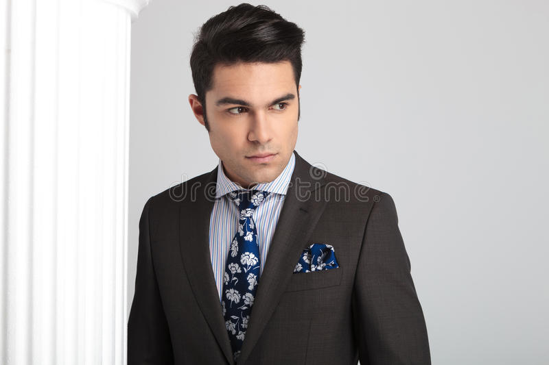 Elegant business man looking away from the camera royalty free stock images