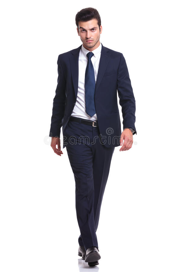 Elegant business man walking on white background royalty free stock photography
