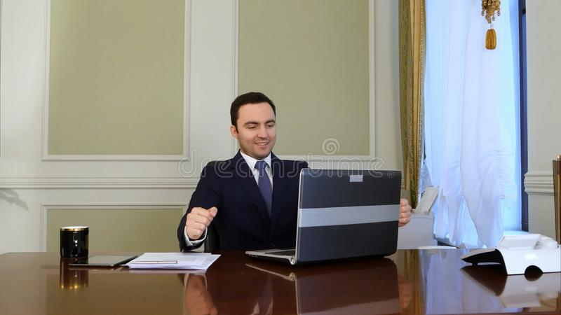 Elegant business man in white shirt correcting his tie and buttoning his suit jacket and starts working royalty free stock photo