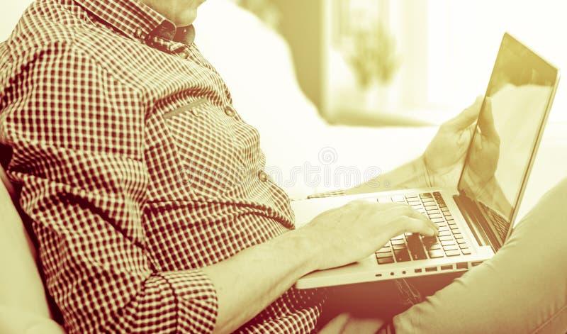Elegant business multitasking multimedia man using devices at home.  royalty free stock photos