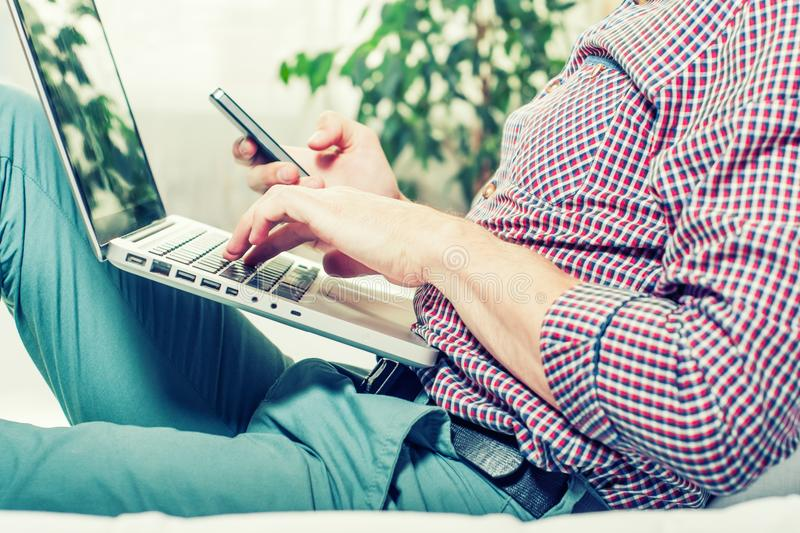 Elegant business multitasking multimedia man using devices at home.  stock image