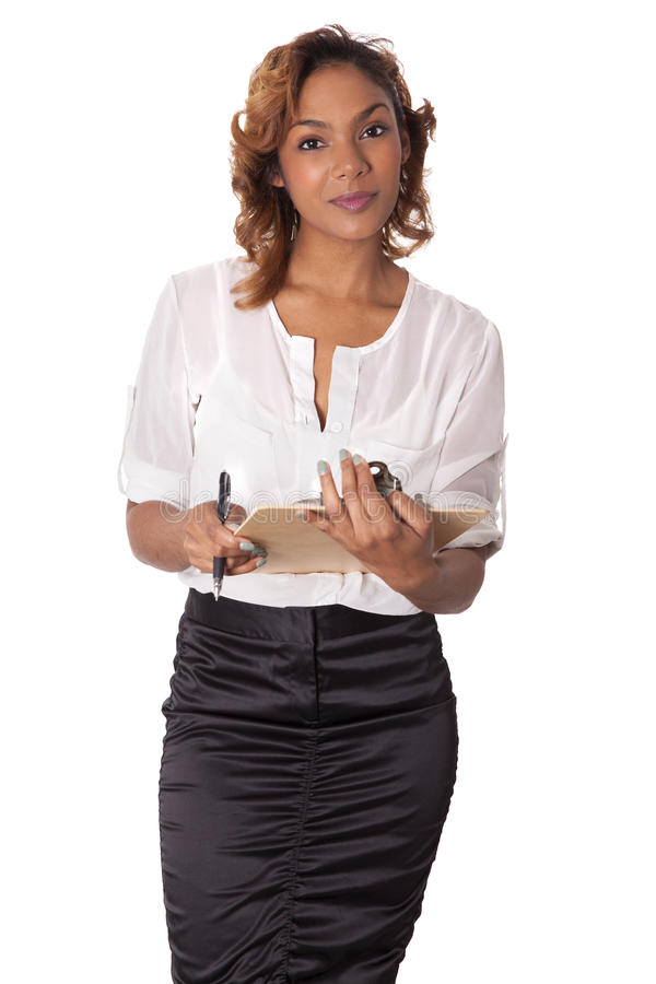 Elegant business woman holds a clipboard. stock photos
