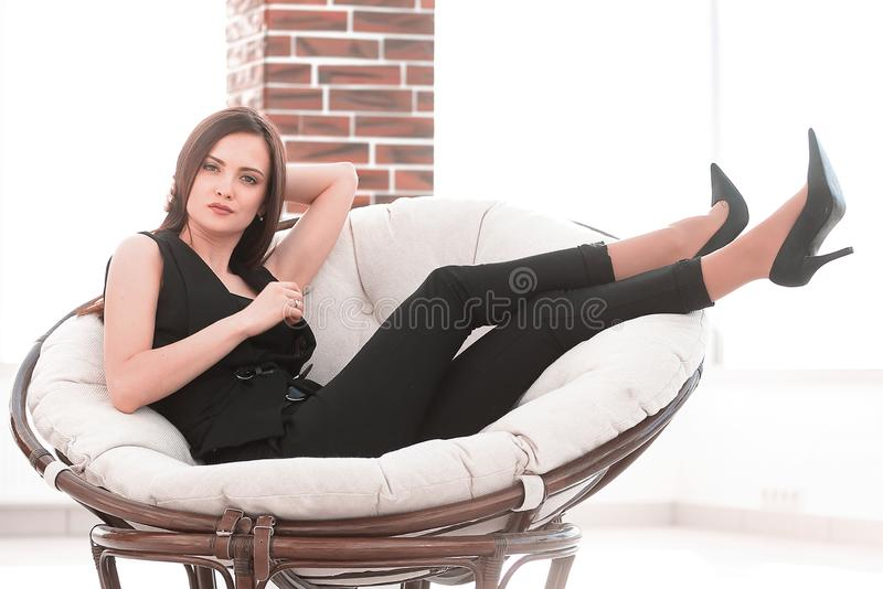 Elegant business woman sitting in a comfortable chair. royalty free stock photos