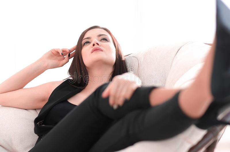 Elegant business woman sitting in a comfortable chair. stock photography