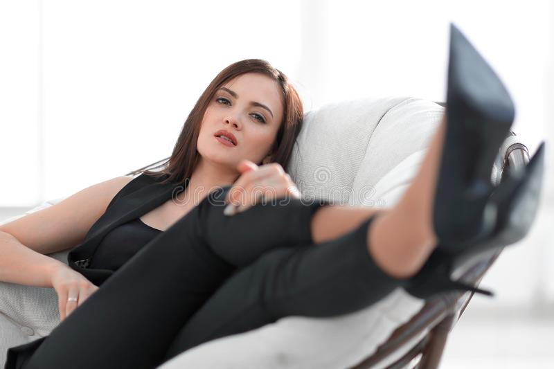 Elegant business woman sitting in a comfortable chair. royalty free stock photography