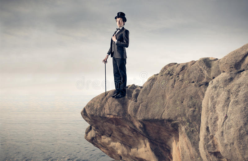 Download Elegant Businessman On A Rock Stock Photo - Image of nature, vintage: 39513826