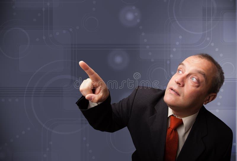Elegant businessman touching copy space. Elegant businessman standing and touching copy space stock photos