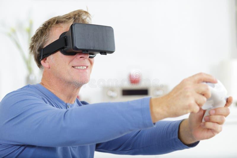 Elegant businessman using vr headset stock photography