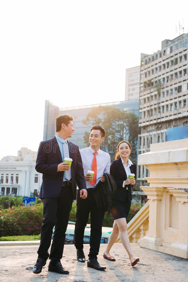 Elegant businesspeople walking in a modern city stock image