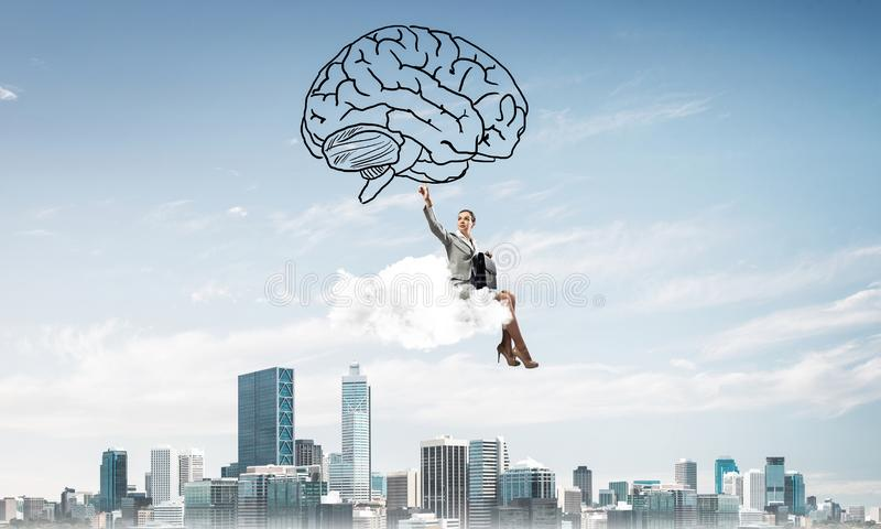 Concept of brainstorming and mind ability with attractive business lady royalty free stock photography