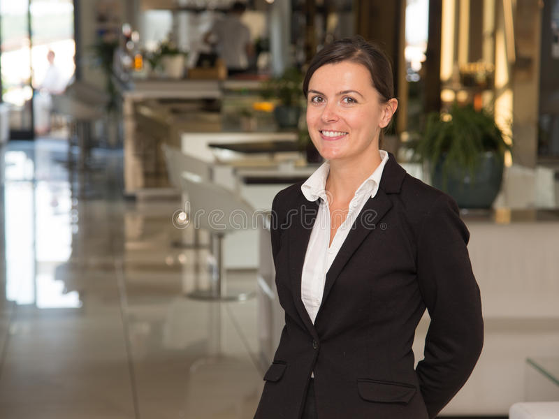 Elegant and cheerful woman receptionist. Elegant and cheerful woman as receptionist royalty free stock image