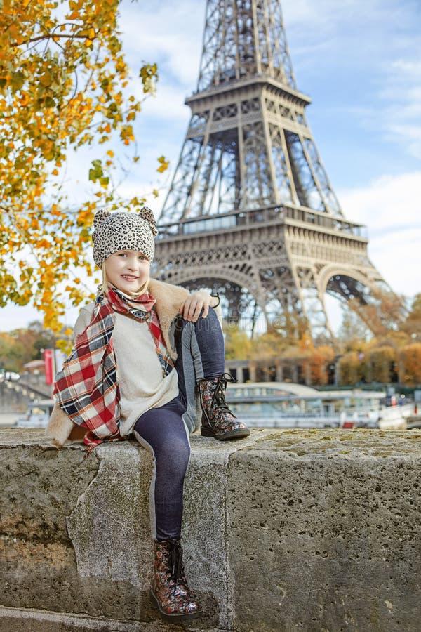 Free Elegant Child On Embankment In Paris Sitting On The Parapet Stock Image - 77410711