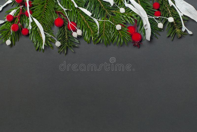 Elegant christmas background on black paper. Top view royalty free stock photo